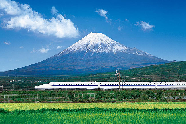 Shinkansen (bullet train) passing by Mount Fuji